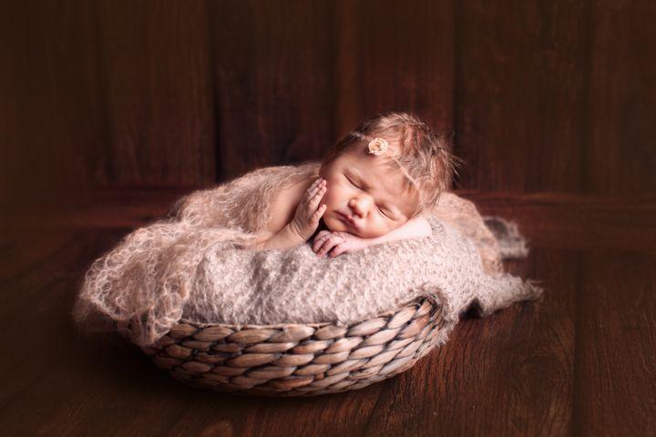 Фотосессия новорожденной девочки