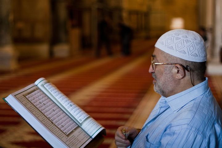 Muslim reads the Quran