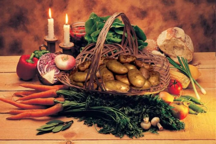 various vegetables in a basket and candles