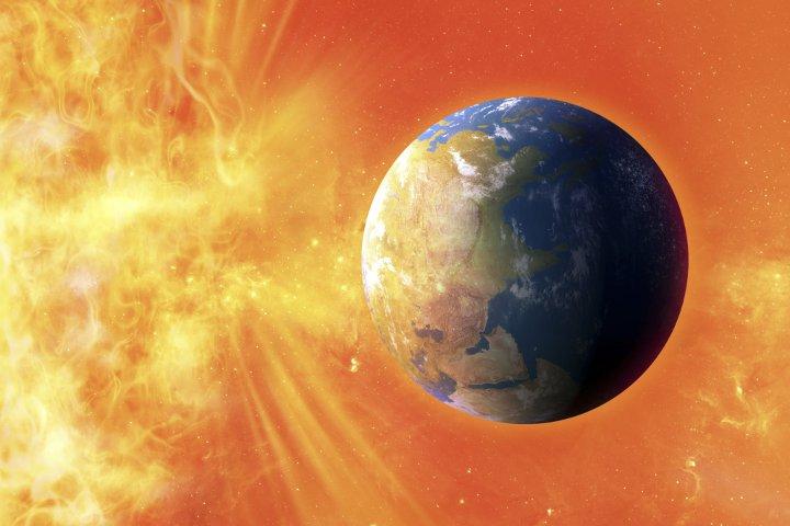 земля на фоне солнечного излучения